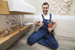 smiling-sanitary-technician-gesturing-thumb-up_23-2147772200-300x200.jpg