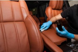 applying-leather-conditioner-to-interior-of-luxery-car-resize-2.jpg
