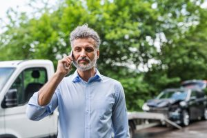 mature-man-making-a-phone-call-after-a-car-accident-copy-space_orig.jpg
