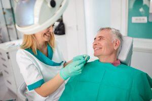 senior-male-in-dental-chair_gettyimages-601145450.jpg